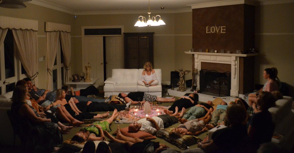 Lyza leading a meditation evening during the meditation.